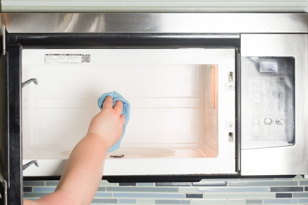 How to scrub the inside of a microwave